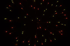 Abstract Background: Fireworks Dispersion in Christmas Colors Stock Photos