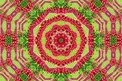 Abstract background of flower pattern of a kaleidoscope. Red green background mandala. abstract kaleidoscopic arabesque. geometrical ornament floral pattern stock photo