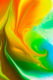 Abstract Background flowing color through milk Stock Photos