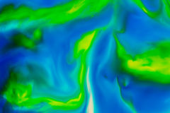 Abstract Background flowing color through milk Stock Photography