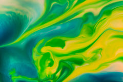 Abstract Background flowing color through milk stock images