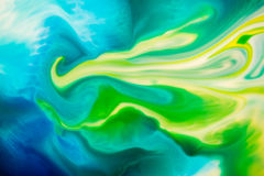 Abstract Background flowing color through milk. Milk with foodcoloring makes some great backgrounds and textures Stock Photo
