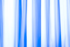 Abstract Background flowing lines of a curtain. A curtain before a window with lots of sunlight, colored with gels, shot with a longer exposure during up and stock illustration