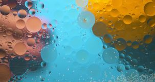 Abstract Background from flowing oil stains. Blue and yellow colors stock video footage