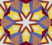 Abstract background with geometric kaleidoscopic design obtained from multicolored flower petals part of a large flower carpet Stock Photos
