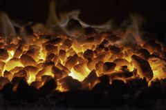 Abstract background of glowing coals in fireplace with fire flames. Burning flame background.  stock images