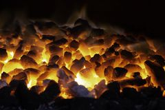 Abstract background of glowing coals in fireplace with fire flames. Burning flame background.  royalty free stock image