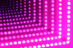 Abstract background of glowing dotted neon lights, perspective view. Abstract futuristic background of glowing dotted neon lights, perspective view stock image