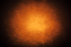Abstract background with glowing spot light. Abstract background with orange glowing spot light Royalty Free Stock Image