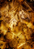 Abstract background gold color. Crumpled golden paper. Paper texture royalty free stock photo