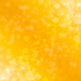 Abstract background with Gold glitter sparkles rays lights bokeh and stars. Gold Festive Christmas background. Stock Photos