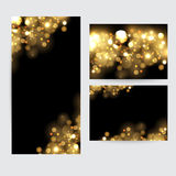 Abstract background with gold sparkles. Shiny defocused gold bokeh lights on black background. Stock Image
