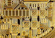 Abstract background : Golden electronic circuit, macro photo. Im. Age taken from gold plated coin stamped in form of electronic circuit as normally seen in PCB Royalty Free Stock Photo