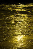 Abstract background with golden flowing water Stock Photo