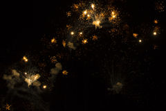 Abstract Background: Golden Glittering Fireworks Royalty Free Stock Photography