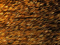 Abstract background with golden glitters Stock Photos