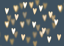 Abstract background with golden heart shaped bokeh lights. Love concept Royalty Free Stock Photo