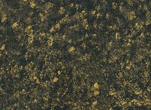 Abstract background with golden splashes texture on black paper Stock Images