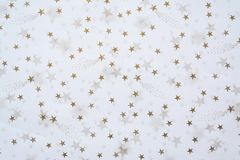 Abstract background with golden stars on a white background stock photos