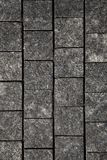 Abstract background of gray cobblestone pavement,close-up, top view. Vertical image royalty free stock photo