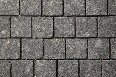 Abstract background of gray cobblestone pavement,close-up, top view. Stone texture royalty free stock photography
