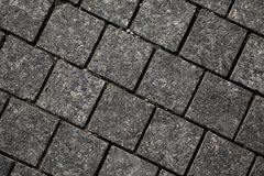 Abstract background of gray cobblestone pavement,close-up, top view. Stone texture stock photos