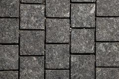 Abstract background of gray cobblestone pavement,close-up, top view. Stone texture royalty free stock images