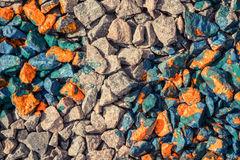 Abstract background of gray stones and rocks covered with red paint Stock Image