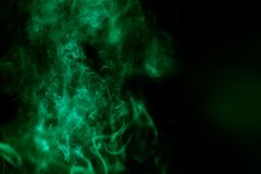 Abstract background with green colored smoke Stock Image