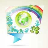Abstract background with green Earth. Clover, rainbow and drops of water Stock Photos