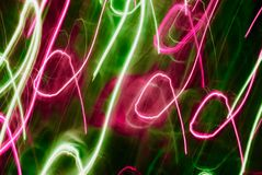 Abstract background in green and pink tones. Blurred colorful lights in motion. Abstract background in green and pink tones royalty free illustration