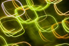 Abstract background in green tones. Blurred colorful lights in motion. Abstract background in green tones stock illustration
