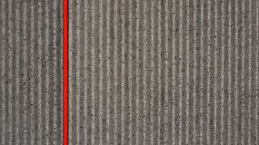 Abstract background grey concrete red stripe Royalty Free Stock Image