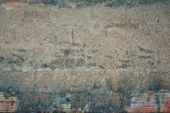 Masonry wall with concrete plaster. Abstract background grey concrete wall texture with masonry shapes underneath the plaster. Cement grunge seamless pattern royalty free stock photography