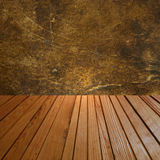 Abstract background with grunge wall and wooden floor. Stock Image