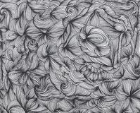 Abstract background of hand drawn doodles. Curly waves and lines. Abstract black and white background of hand drawn doodles. Curly waves and lines. Creative Royalty Free Stock Photos