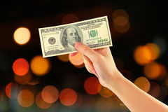 Abstract background with hand holding money Royalty Free Stock Photography
