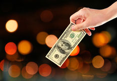 Abstract background with hand holding money Stock Photo