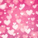 Abstract background with hearts and bokeh lights. Abstract romantic pink background with hearts and bokeh lights. St. Valentine`s day wallpaper. Blurred glow Royalty Free Stock Photo
