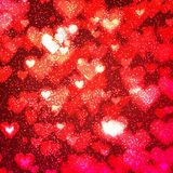 Abstract background with hearts and bokeh lights. Abstract romantic red background with hearts and bokeh lights. St. Valentine`s day wallpaper. Blurred glow Stock Photography