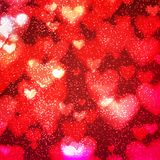 Abstract background with hearts and bokeh lights. Abstract romantic red background with hearts and bokeh lights. St. Valentine`s day wallpaper. Blurred glow Stock Images