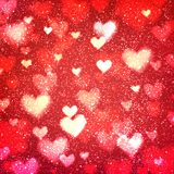 Abstract background with hearts and bokeh lights. Abstract romantic red background with hearts and bokeh lights. St. Valentine`s day wallpaper. Blurred glow Royalty Free Stock Photography
