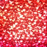 Abstract background with hearts and bokeh lights. Abstract romantic red background with hearts and bokeh lights. St. Valentine`s day wallpaper. Blurred glow Royalty Free Stock Images