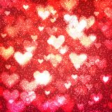 Abstract background with hearts and bokeh lights. Abstract romantic red background with hearts and bokeh lights. St. Valentine`s day wallpaper. Blurred glow Stock Image