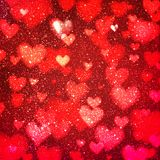 Abstract background with hearts and bokeh lights. Abstract romantic red background with hearts and bokeh lights. St. Valentine`s day wallpaper. Blurred glow Stock Photos