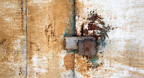 Abstract background with holes and locking screws, and the texture of the rust orange-brown with spots. A horizontal. Abstract background with holes and locking royalty free stock images