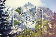 Collage with the mountain landscape and the sacred geometry symbol. Abstract background with the image of the mountain landscape and the sacred geometry symbol royalty free stock images