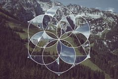 Geometric collage with the mountains and sacred geometry. Abstract background with the image of the mountains, forest and meadow. Harmony, spirituality, unity of stock photography