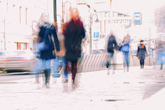 Abstract background. Intentional motion blur. City in the early spring. Street, people walking along the sidewalk Royalty Free Stock Images