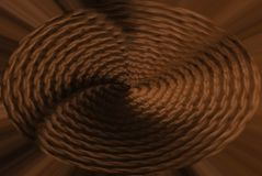 Abstract background, knitted fabric with a spiral in the center brown. Stylish basis for design royalty free illustration